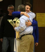 Horseheads boys basketball coach Jeff Limoncelli hugs senior Henry Juan during Senior Night on Feb. 8, 2020 against Binghamton at Horseheads Middle School.