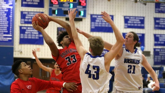 Xymier Thomas of Binghamton looks for room to shoot as Horseheads' Connor Godwin (43) and Patrick Carpenter (21) defend during the Patriots' 94-62 win in boys basketball Feb. 8, 2020 at Horseheads Middle School.