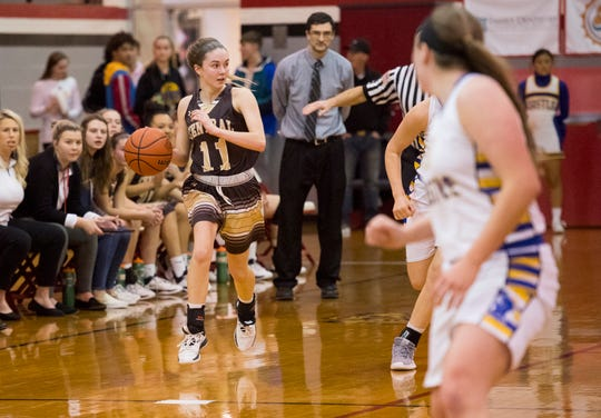 Central's Faith Frank (11) dribbles the ball during the IHSAA Class 4A girls basketball sectional game against the Castle Knights at Harrison High School Friday evening, Feb. 7, 2020.