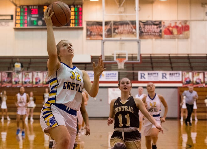 Castle's Natalie Niehaus (32) takes a shot during the IHSAA Class 4A girls basketball sectional game against the Central Bears at Harrison High School Friday evening, Feb. 7, 2020.