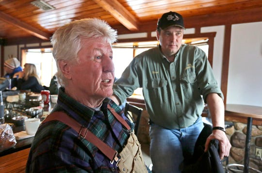 The Pipe Fishing Club's Jerry Keifenheim, left, and Steve Morgen, right, talk about the impact of the sturgeon season while at Jim and Linda's Supper Club registration station, Saturday, February 8, 2020, in Pipe, Wis.