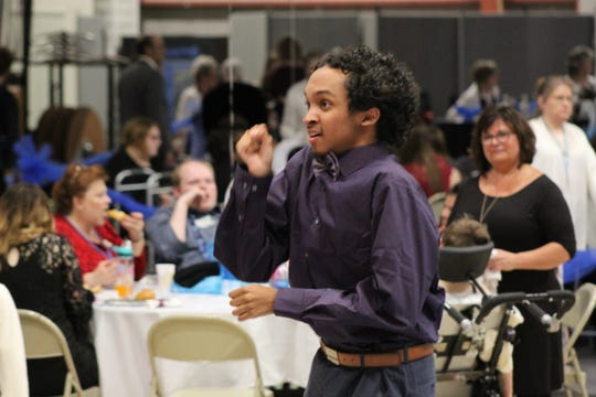 "Silas Cover of Fremont dances to the music of the Together Band Friday at the annual  ""Night to Shine"" prom, hosted by New Hope Vineyard Church at Terra State Community College."