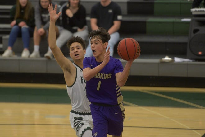 Fort Collins basketball player Raymond Johnson passes during a game against Fossil Ridge on Friday, Feb. 7, 2020. Fossil Ridge won 72-39.