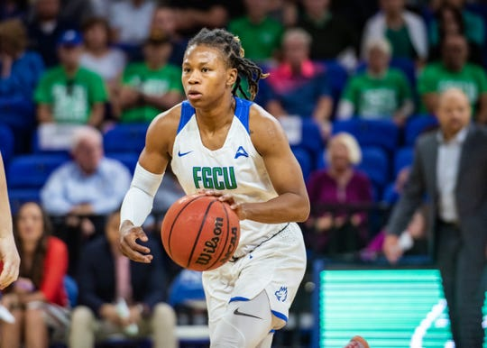 FGCU's Keri Jewett-Giles brings the ball up court against North Florida on Saturday, Feb. 8. The Eagles, ranked 24th in the country, defeated the Ospreys 76-65.