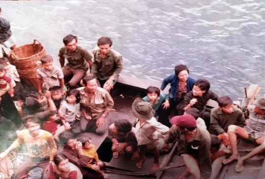 This picture shows a boat carrying refugees fleeing Vietnam tied to a Sea-Land shipping vessel in July 1978. Passengers aboard the small boat were signaling for help and the freighter stopped to help and eventually rescued all 51 passengers aboard. Pictured at top left (in front of a basket) is then 12-year-old Fort Walton Beach resident Minh Nguyen. When he decided to start his own restaurant, Nguyen named it Sealand, after the vessel and company that saved the lives of his family.