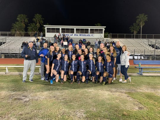 The Estero girls soccer team smiles and celebrates following a victory over Naples in the 5A-12 championship. The Wildcats won 4-3 in penalty kicks.