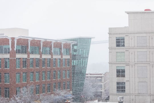 Downtown Greenville sees snow after a week of severe rain, Saturday, Feb. 8, 2020.