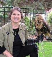 Bird rehabilitator Kari Gabriel and Hawkeye.