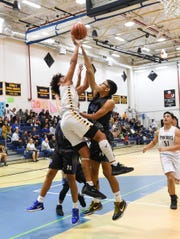 In this file photo from early February, Guam High School's Travon Jacobs (2) grabs a rebound for the Panthers. Guam High defeated Okkodo High School in the opening round of the Boys Basketball National Championships, 80-71 in overtime, to advance to the semifinals against the Harvest Christian Academy Eagles.