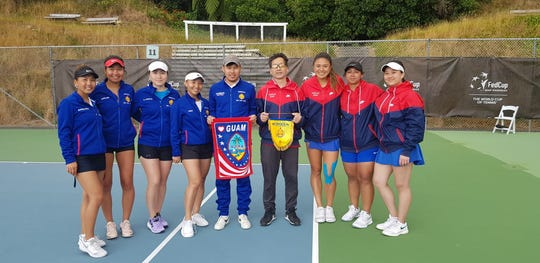 Team Guam, in red, poses for a neighborly shot with Team Mongolia before their Pen Fed qualifying match in Wellington, New Zealand. Guam is shown from left, captain Sam Lai, Nadine Del Carmen, Charmayne Espinosa and Katie Lai.