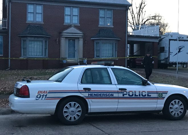 An HPD officer walks away from a house on Jackson Street where a death investigation is underway (Feb. 7, 2020).