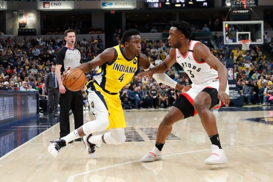 Feb 7, 2020; Indianapolis, Indiana, USA; Indiana Pacers guard Victor Oladipo (4) drives to the basket against Toronto Raptors forward OG Anunoby (3) during the first quarter at Bankers Life Fieldhouse. Mandatory Credit: Brian Spurlock-USA TODAY Sports
