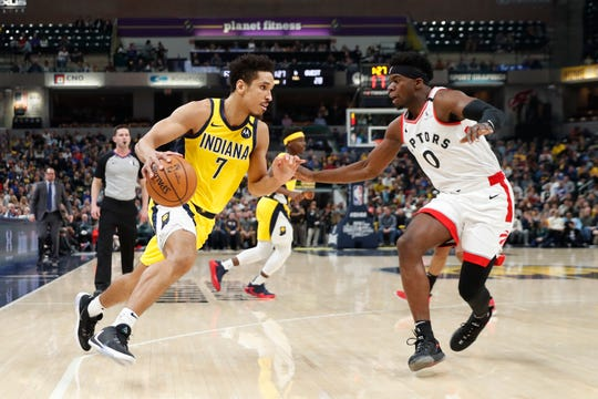 Feb 7, 2020; Indianapolis, Indiana, USA; Indiana Pacers guard Malcolm Brogdon (7) drives to the basket against Toronto Raptors guard Terence Davis II (0) during the first quarter at Bankers Life Fieldhouse. Mandatory Credit: Brian Spurlock-USA TODAY Sports