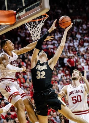 Purdue Boilermakers center Matt Haarms (32) shoots for the hoop while Indiana Hoosiers forward Trayce Jackson-Davis (4), and Indiana Hoosiers forward Joey Brunk (50) try to stop him during a game between the Indiana University Hoosiers and the Purdue Boilermakers at Simon Skjodt Assembly Hall in Bloomington, Ind., Saturday, Feb. 8, 2020.