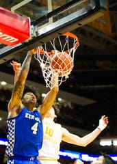 Kentucky forward Nick Richards (4) dunks the ball during the University of Kentucky and University of Tennessee men's basketball game on Saturday, Feb. 8, 2020 at the Thompson-Boling Arena in Knoxville, Tennessee.