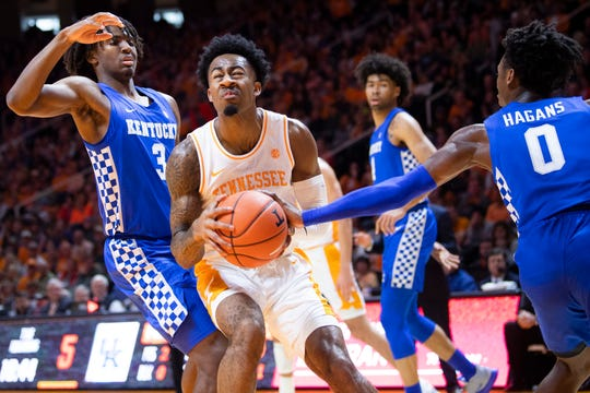 Kentucky guard Ashton Hagans (0) bats the ball away from Tennessee guard Jordan Bowden (23) during a basketball game between the Tennessee Volunteers and the Kentucky Wildcats at Thompson-Boling Arena in Knoxville, Tenn., on Saturday, February 8, 2020.