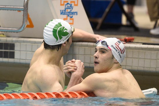 Webb's Michael McClamroch and Oakland's Joseph Jordan shake hands after the second heat of the men's 50-yard freestyle Friday.