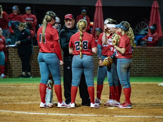 UL coach Gerry Glasco holds a meeting in the circle with his Ragin' Cajuns during their 2020 season opener against Ball State at Lamson Park.