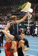 Armand Duplantis of Sweden celebrates after setting a new World Record (6.17) in the men's Pole Vault final during the indoor athletics meeting Orlen Copernicus Cup 2020 in Torun, Poland, Saturday Feb. 8, 2020. (AP Photo/Slawek Kowalski)