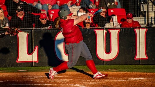 UL's Bailey Curry gets a hit during the Ragin' Cajun softball team's season opener against Ball State Friday, Feb. 7, 2020.