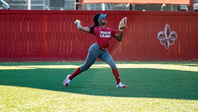 UL's Raina O'Neal throws the ball back to the infield during the Ragin' Cajun softball team's season opener against Ball State Friday, Feb. 7, 2020.