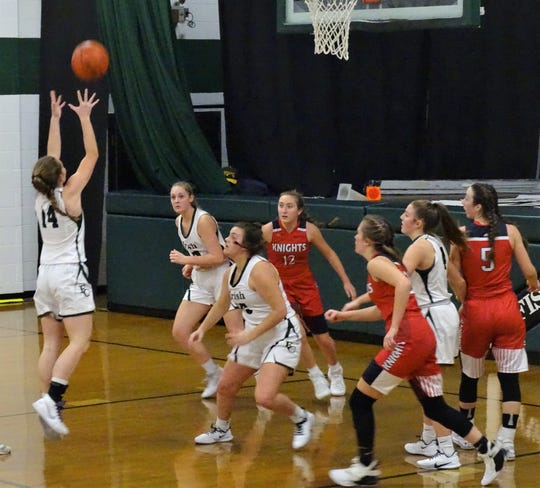 Fisher Catholic's Lucy Reed pulls down a rebound during the Irish's 46-37 win over Fairfield Christian Academy Friday night.
