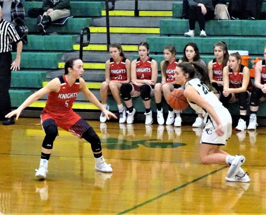 Fisher Catholic's Paige Gavin dribbles against Fairfield Christian Academy's Hope Custer during the Irish's 46-37 upset win Friday night.