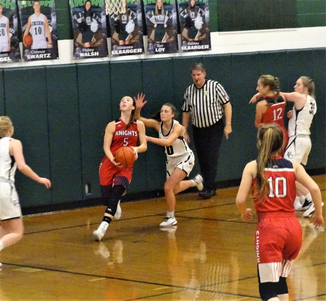 Fairfield Christian Academy's Hope Custer shoots a reverse layup during the Knights' 46-37 loss against Fisher Catholic Friday night.