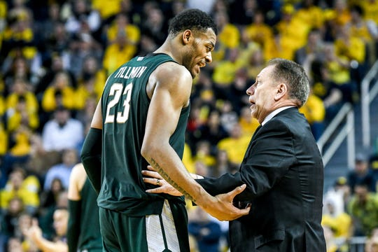Michigan State's Xavier Tillman, left, talks with head coach Tom Izzo during the second half on Saturday, Feb. 8, 2020, at the Crisler Center in Ann Arbor.