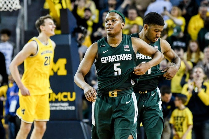 Michigan State's Cassius Winston, left, and Aaron Henry leave the court after losing to Michigan 77-68 on Saturday, Feb. 8, 2020, at the Crisler Center in Ann Arbor.