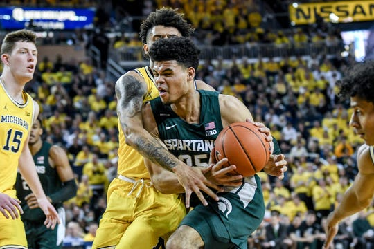 Michigan State's Malik Hall is fouled while going to the hoop during the first half on Saturday, Feb. 8, 2020, at the Crisler Center in Ann Arbor.