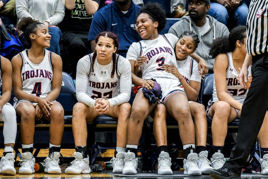 From left, East Lansing Sanaya Gregory, Ahlura Lofton, Kalaia Hampton and Sug Williams sit on the bench during the final seconds of the game on Friday, Feb. 7, 2020, in East Lansing. The four and fellow teammates Aaliyah Nye and Paris Hayes celebrated senior night following the game.