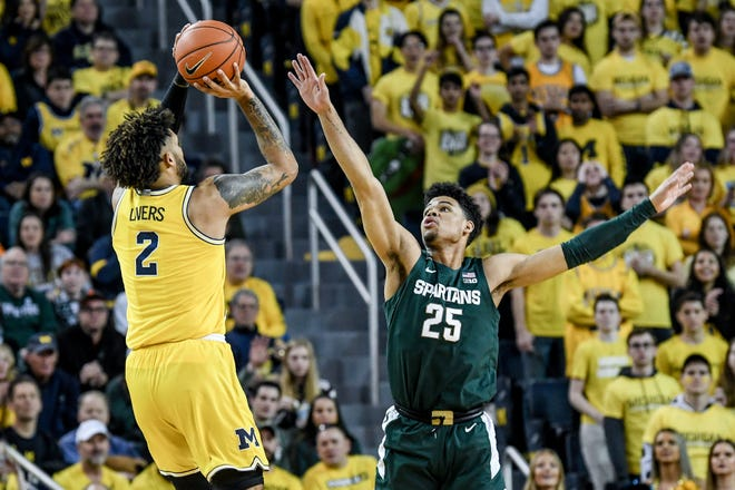 MSU's Malik Hall guards Michigan's Isaiah Livers during their matchup last February at Crisler Center.
