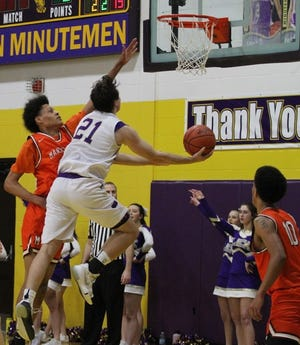 Mansfield Senior's D'Angelo Chapman tries to block the shot of Lexington's Dylan Spears in Friday night's Ohio Cardinal Conference basketball game