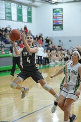 Shelby's Sophie Niese finishes a tricky layup on Friday night in a win over Clear Fork.