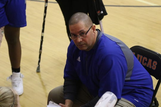 St. Peter's Girls Basketball coach Roy Shoulders instructs his team during a game last season.