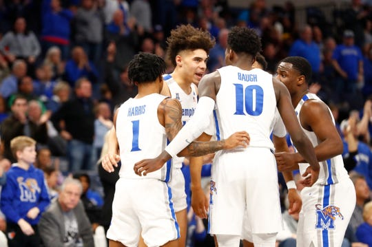 Memphis Tigers players huddle up s they take on the South Florida Bulls at the FedExForum on Saturday, Feb. 8, 2020.