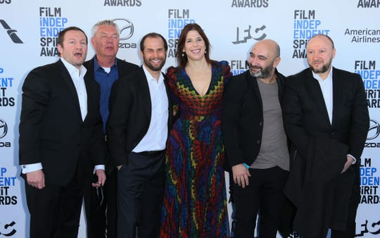"""The team behind """"Give Me Liberty,"""" including director and co-writer Kirill Mikhanovsky, left, and Alice Austen, fourth from left, arrive for the Film Independent Spirit Awards in Santa Monica, California, Saturday. The movie took home the John Cassavetes Award, going to the independent movie made on a budget under $500,000."""