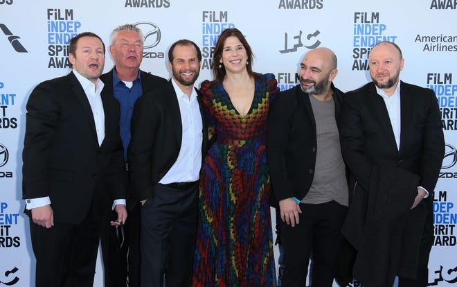 "The team behind ""Give Me Liberty,"" including director and co-writer Kirill Mikhanovsky, left, and Alice Austen, fourth from left, arrive for the Film Independent Spirit Awards in Santa Monica, California, Saturday. The movie took home the John Cassavetes Award, going to the independent movie made on a budget under $500,000."