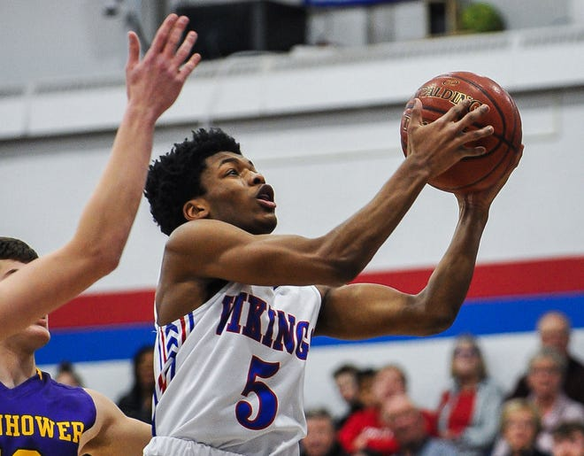 Wisconsin Lutheran guard Jordan Glenn (5) goes up for a layup against New Berlin Eisenhower during a game last year.