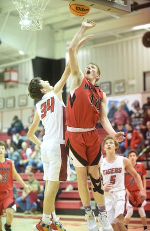 Norfork's Will Martin goes up for two during a recent game at Lead Hill. The Panthers defeated Bakersfield, Mo., on Friday night.