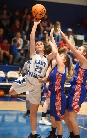 Cotter's Paige Clawson is fouled while shooting a layup during a game earlier this season at Cotter. The Lady Warriors won their first conference title since 2011 on Friday night.