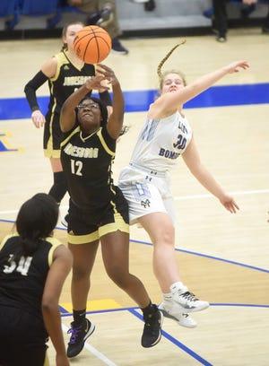 Mountain Home's Addison Yates battles Jonesboro's Chasity Jackson for a rebound on Friday night.