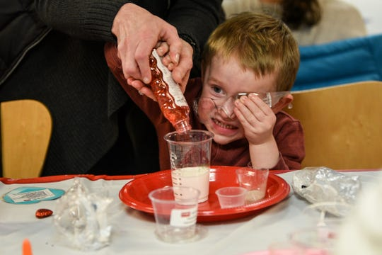 Landon Neaman, 2 from West Orange, holds onto his safety goggles as he makes chocolate scented slime during the chocolate family fun day at the Morris Museum in Morris on Saturday February 8, 2020.
