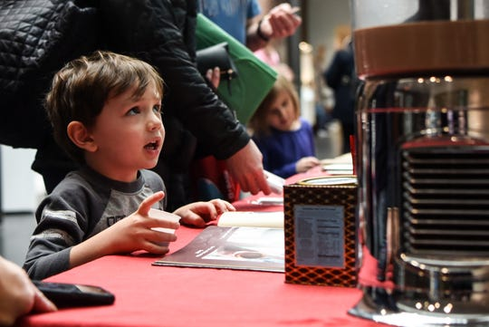 Darien, 3 from Parsippany, tests out the hot chocolate from the Chocolate Path during chocolate family fun day at the Morris Museum in Morris on Saturday February 8, 2020.