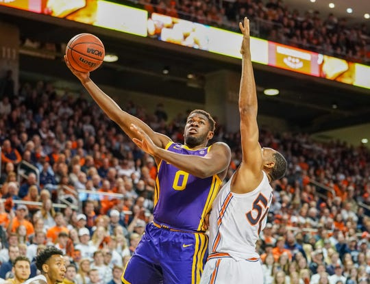 Feb 8, 2020; Auburn, Alabama, USA; LSU Tigers forward Darius Days (0) shoots the ball around Auburn Tigers center Austin Wiley (50) during the firs half at Auburn Arena. Mandatory Credit: Marvin Gentry-USA TODAY Sports
