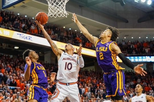 Feb 8, 2020; Auburn, Alabama, USA; Auburn Tigers guard Samir Doughty (10) shoots against LSU Tigers guard Javonte Smart (1) and forward Trendon Watford (2) during the second half at Auburn Arena. Mandatory Credit: Marvin Gentry-USA TODAY Sports