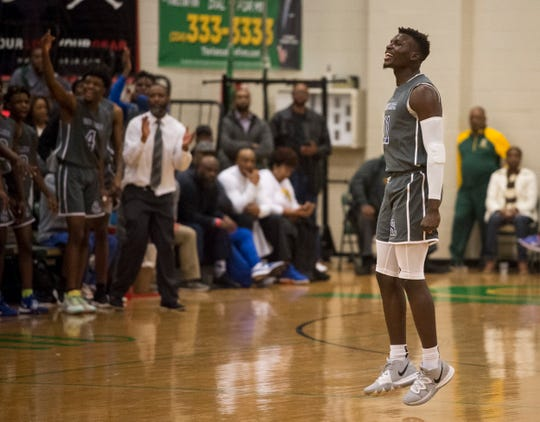 Lanier's Antwan Burnett (11) reacts after making a three pointer during the Class 6A, Area 4 championship at Carver High School in Montgomery, Ala., on Friday, Feb. 7, 2020.