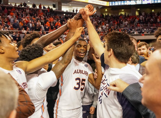 Auburn Tigers guard Devan Cambridge (35) celebrates with his teammates after a win over LSU in overtime at Auburn Arena on Feb. 8, 2020.