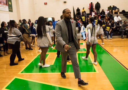 Lanier coach Brian Williams takes the court before his team takes on Carver during the Class 6A, Area 4 championship at Carver High School in Montgomery, Ala., on Friday, Feb. 7, 2020.